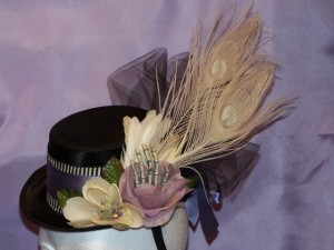 Dusk Hat with flowers, skeleton hand and cream peacock feathers
