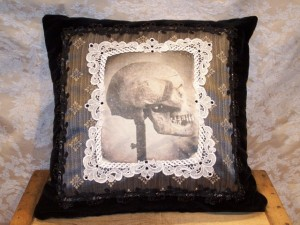 Specimen Black velvet pillow with skull applique and vintage lace frame