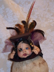 Strange New World Steampunk horror hat with doll head and arms